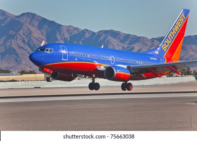 LAS VEGAS - NOVEMBER 12: Boeing 737 Southwest lands on McCarran in Las Vegas, NV, USA on November 12, 2010. Plane is wearing house livery. Las Vegas is the main hub of the Southwest Airlines