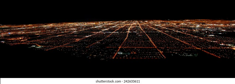 LAS VEGAS - NOVEMBER 26, 2011: Panoramic view of famous Las Vegas seen from elevation at night.  The Strip is world famous for its extravagant hotel casinos.