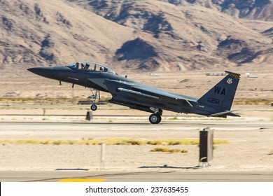 LAS VEGAS -NOVEMBER 8: F-15 Eagle lands at Nellis AFB  during Aviation Nation airshow on November 8,2014 in Las Vegas,NV. F-15 is a tactical fighter. It was designed by McDonnell Douglas.