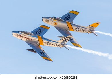 LAS VEGAS -NOVEMBER 8: Two P-51 Mustangs perform during Aviation Nation at Nellis AFB on November 8,2014 in Las Vegas,NV. P-51 was an American fighter used during World War II and other conflicts.