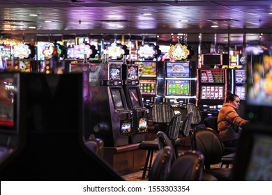"Las Vegas, NV 11/1/2019 — Slot machines at the Binion's. One woman playing at a machine. The property reopened Feb. 2019 with the famous Apache Hotel that ""made poker famous."""