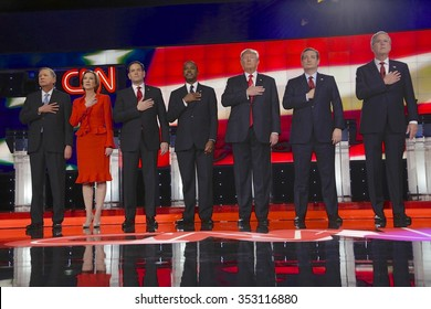 LAS VEGAS, NV - DEC, 15, 2015: Republican presidential candidates (L-R) John Kasich, Carly Fiorina, Sen. Marco Rubio, Ben Carson, Donald Trump, Sen. Ted Cruz, Jeb Bush hold hand over heart for pledge