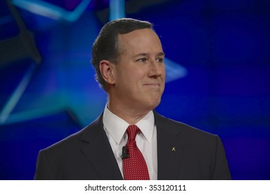 LAS VEGAS, NV, Dec 15, 2015, former Senator Rick Santorum smiles, a Republican and 2016 presidential candidate, claps on stage at the start of the Republican presidential