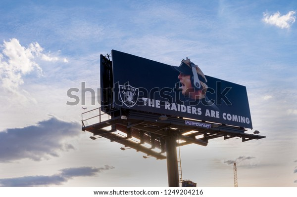 Las Vegas, NV - December 1, 2018. Billboard on the Las Vegas Strip announcing that the Oakland Raiders NFL team are moving to Las Vegas in 2020.