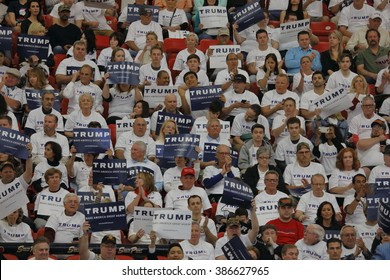 LAS VEGAS, NV - FEBRUARY 22: Supporters cheer underneath US Flag as they wait for Republican presidential candidate Donald Trump to speak at a rally at the South Point Las Vegas, Nevada.