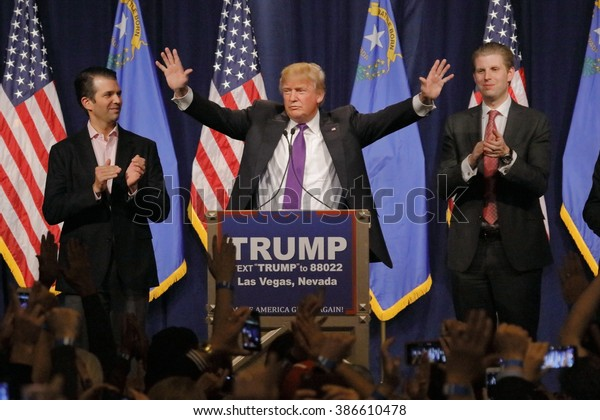 LAS VEGAS, NV - FEBRUARY 23, 2016: Donald Trump is flanked by sons Eric (Right) and Donald Jr. (Left) during Mr. Trump's victory speech after Nevada caucus, Las Vegas, NV at Treasure Island Casino and Hotel