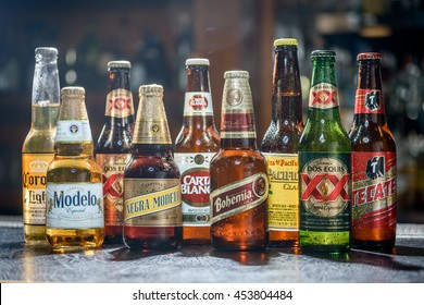 LAS VEGAS, NV - JULY 17, 2016: Popular Mexican Beers. Pacifico, Corona, Bohemia, Tecate and Modelo beer bottles on a bar counter top.