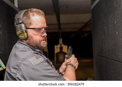 Las Vegas, NV: July 2015: firearms instructor at the The Vegas Machine Gun Experience store gives safety instructions.  Machine guns have become a popular tourist attraction in Las Vegas.
