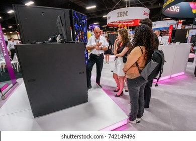 LAS VEGAS, NV - JUNE 10, 2013: Attendees listen stand-attendant at Intel booth of exhibition in frame of IBM Edge 2013 conference on June 10, 2013 in Las Vegas, NV