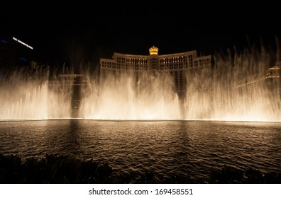 LAS VEGAS, NV -  JUNE 12, 2013:  Las Vegas Bellagio Hotel Casino featured with its famous fountain show at night on June 12, 2013 in Las Vegas, Nevada. Multiple water shows take place every day.