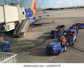 Las Vegas, NV - June 2, 2018: Las Vegas airport with Southwest plane at gate unloading passengers.