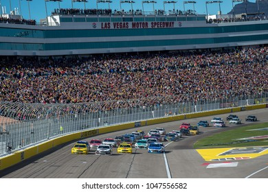 LAS VEGAS, NV - MAR 04:  4 wide after a restart at the NASCAR Monster Energy Cup Series Pennzoil 400 race at Las Vegas Motorspeedway in Las Vegas on March 04, 2018