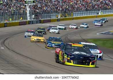 LAS VEGAS, NV - MAR 04:  William Byron (24) leadint a group of cars at the NASCAR Monster Energy Cup Series Pennzoil 400 race at Las Vegas Motorspeedway in Las Vegas on March 04, 2018