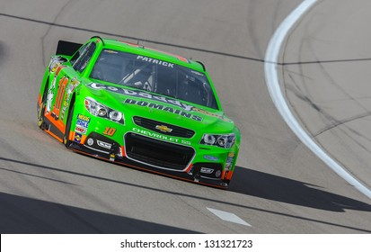 LAS VEGAS, NV - MAR 07, 2013:  Danica Patrick (10) brings her Chevrolet SS through the turns during the Kobalt Tools 400 at Las Vegas Motor Speedway in Las Vegas, NV on March 07, 2013.