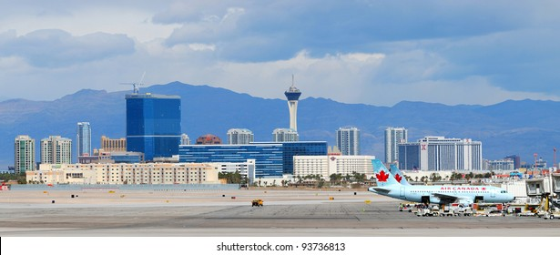 LAS VEGAS, NV - MAR 4: McCarran Airport and Vegas skyline on March 4, 2010 in Las Vegas, Nevada. McCarran ranked 15th in the world for passenger traffic in 2008 due to the fabulous Vegas attractions.
