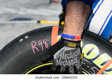 LAS VEGAS, NV - March 07: Crew member with spare tire at the NASCAR Boyd Gaming 300 Xfinity race at Las Vegas Motor Speedway in Las Vegas, NV on March 07, 2015