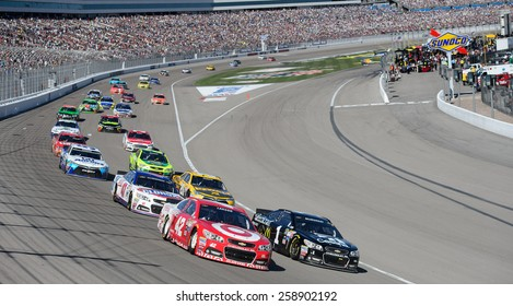 LAS VEGAS, NV - March 08: Kyle Larson (42) and Jamie McMurray (1) lead the field at the NASCAR Sprint Kobalt 400 race at Las Vegas Motor Speedway on March 08, 2015