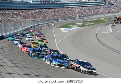 LAS VEGAS, NV - March 08: Kevin Harvick leads at the NASCAR Sprint Kobalt 400 race at Las Vegas Motor Speedway on March 08, 2015