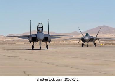 LAS VEGAS, NV - NOV 7:  F-15 Eagle and F-22 Raptor supersonic jet fighters at Aviation Nation 2008 Airshow, November 7, 2008 at Nellis AFB, Las Vegas, NV