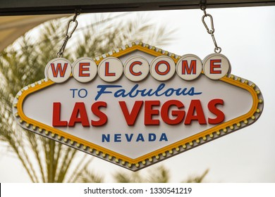 "LAS VEGAS, NV, USA - FEBRUARY 2019: Neon sign ""Welcome to Fabulous Las Vegas"" above the entrance of a souvenir shop in Las Vegas."