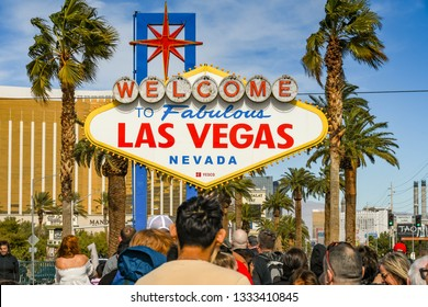 "LAS VEGAS, NV, USA - FEBRUARY 2019: People queuing to have their picture taken in front of the famous ""Welcome to Las Vegas"" sign. The sign is at the southern end of Las Vegas Boulevard. ."