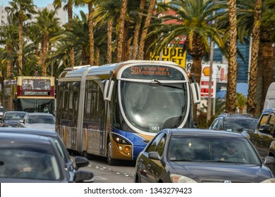 LAS VEGAS, NV, USA - FEBRUARY 2019: An articulated bus on the SDX Express route driving along Las Vegas Boulevard in heavy traffic.