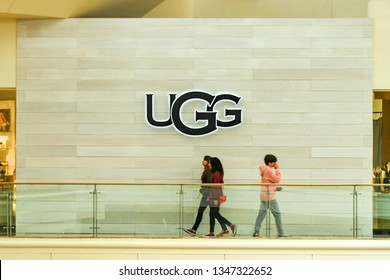 LAS VEGAS, NV, USA - FEBRUARY 2019: Young people walking past the logo of UGG in a shopping mall in Las Vegas.