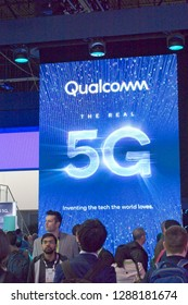 Las Vegas, NV, USA, Jan. 8, 2019: The Qualcomm exhibit at the 2019 CES show foretells the future of cellular phones with the push into 5G technology.