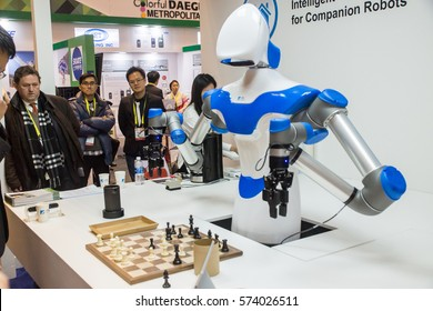 Las Vegas, NV, USA - January. 7, 2017: A highly skilled robot made in China challenges humans at chess at CES 2017, but can it cook?