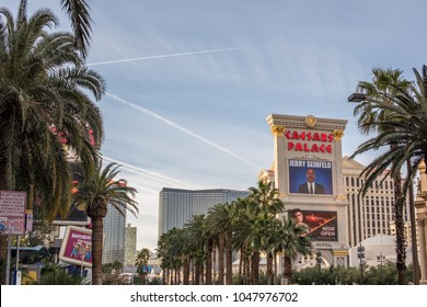 Las Vegas, NV / USA - March 6, 2018:View north of Las Vegas Boulevard, with a row of palm trees and the Caesar's Palace sign visible, advertising a Jerry Seinfeld show. Las Vegas is a very scenic city