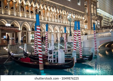 Las Vegas, NV / USA - March 8, 2017: At night, gondolas are docked along the canal at the famous Venetian Hotel and Casino, a popular, Venice-themed hotel on the Las Vegas strip.