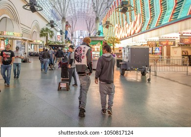 Las Vegas, NV / USA - March 6, 2018: Very stylish young men wearing trendy clothing walk along Fremont Street Experience, downtown Las Vegas.