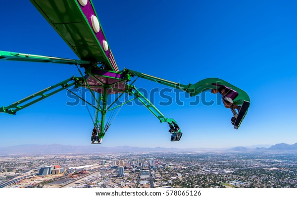 Las Vegas, NV, USA - September 05, 2016 : Insanity ride at top of the Stratosphere tower in Las Vegas Nevada. A massive mechanical arm extending out 64 feet over the edge of the Stratosphere Tower.