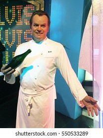 LAS VEGAS, NV-DECEMBER 30, 2016:  Wolfgang Puck, holding a champagne bottle, at Madame Tussauds Wax Museum.