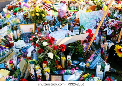 LAS VEGAS - OCT 07 ,2017 : Dedicated flower bed of the Las Vegas Shooting victims attend a candlelight vigil on the Las Vegas Strip Near the Mandalay Bay.