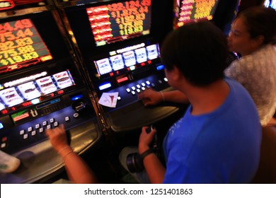 LAS VEGAS - Oct. 11 : Blurred picture of A man playing Casino in Las Vegas , New York ,USA