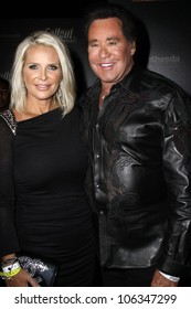 LAS VEGAS - OCTOBER 16: Kathleen McCrone and Wayne Newton walk the red carpet at the launch of Fallout: New Vegas at Rain at Palms Resort & Casino in Las Vegas, NV on October 16, 2010
