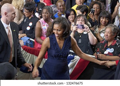 LAS VEGAS - OCTOBER 26: First Lady Michelle Obama with supporters at President Obama`s campaign rally on October 26, 2012 at Orr Middle School in Las Vegas, Nevada.