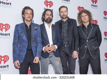 LAS VEGAS - SEP 18 : (L-R) Brandon Flowers, Ronnie Vannucci, Jr., Mark Stoermer and Dave Keuning of The Killers attends the 2015 iHeartRadio Music Festival on September 18, 2015 in Las Vegas.