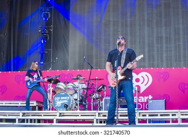 LAS VEGAS - SEP 19 : Singer/songwriter Lee Brice performs onstage at the 2015 iHeartRadio Music Festival at the Las Vegas Village on September 19, 2015 in Las Vegas, Nevada.