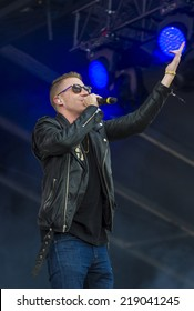 LAS VEGAS - SEP 20: Rapper Macklemore performs on stage at the 2014 iHeartRadio Music Festival Village on September 20, 2014 in Las Vegas.