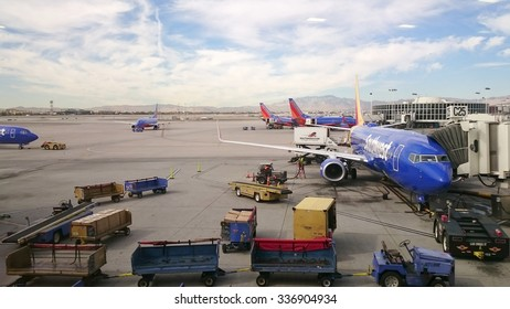 LAS VEGAS, SEP. 26: Southwest Airline airplane Boeing 737  being loaded by baggage handler at the tarmac of McCarran International Airport in Las Vegas, Nevada, United States taken on Sep, 26, 2015.