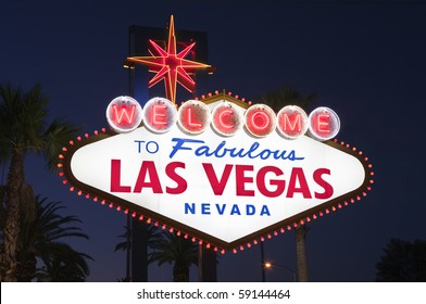 Las Vegas sign with Palms at night.  Overhead wires were removed.