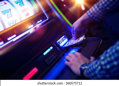 Las Vegas Slot Gambling Addiction. Men Playing Traditional Slot Machine.