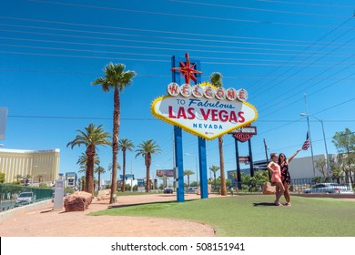 LAS VEGAS, US - JULY 10: People at Welcome to Fabulous Las Vegas sign on July 10, 2016 in Vegas, US. The famous sign is located near Mandalay Bay hotel
