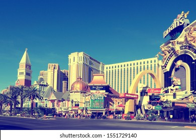 LAS VEGAS, USA - APRIL 14, 2014: People visit the famous Strip in Las Vegas. 15 of 25 largest hotels in the world are located at the strip with more than 60 thousand rooms.