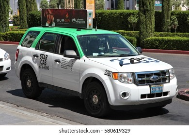LAS VEGAS, USA - APRIL 14, 2014: Taxi cab in Las Vegas, Nevada. Nevada has one of lowest car ownership rates in the USA (500 vehicles per 1000 people).