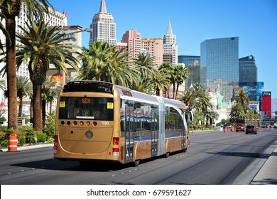LAS VEGAS, USA - APRIL 14, 2014: People ride SDX bus in Las Vegas. SDX is operated by Wright StreetCar articulated hybrid bus manufactured by Wrightbus and Volvo.