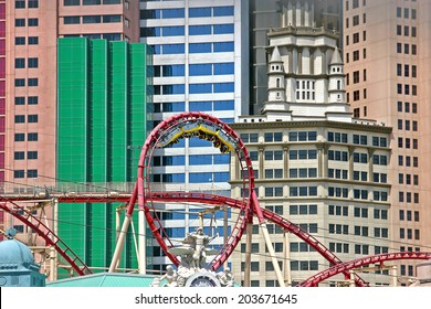 Las Vegas, USA - April 24, 2008: The rollercoaster at the New York, New York hotel in Las Vegas. The cars are at the top of the loop, with people hanging upside down.