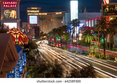 Las Vegas, USA - Circa 2017: Long exposure light trail of busy street night Las Vegas Blvd strip Traffic pass famous hotel casino resorts lit neon light advertisement. Caesars, Mirage, Treasure Island